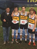 SUBMITTED PHOTO: BOB WEBBER - Canby runners Neal Cranston (middle, left), Tristan Oakes (middle, right) and Cole Thomas (right) pose for a photo with coach Tom Millbrooke after the 6A boys Oregon State Championships race.