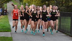 TIMES FILE PHOTO - The Jesuit girls cross country team won the Class 6A state championship at Lane Community College.