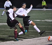 MATTHEW SHERMAN - Ari Akbari slides to try and deflect a Central Catholic pass during the Pacers 2-0 win over the Rams last week.