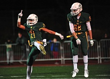 VERN UYETAKE - Qawi Ntsasa celebrates one of his three touchdowns on the night during the Lions 63-21 victory over Lake Oswego.