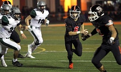TIMES PHOTO: MILES VANCE - Beaverton's Carson Crawford makes a run during his team's 41-28 win over West Salem in the second round of the Class 6A state playoffs on Friday at Beaverton High School.