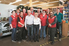 JAIME VALDEZ - Terry and Gale Cain, owners of Ace Hardware, stand with their staff at Progress Ridge TownSquare.