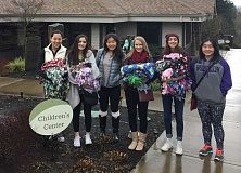 SUBMITTED PHOTO - Members of Youth Action Council are collecting fleece to make blankets for children visiting The Childrens Center in Oregon City. Donations of fleece will be accepted through Dec. 2.