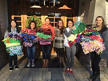 SUBMITTED PHOTO  - Members of Lake Oswegos Youth Action Committee are making fleece blankets for Childrens Center, which serves children suspected to be victims of child abuse and neglect. You can donation fleece fabric to the campaign through Dec. 2.
