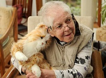 REVIEW PHOTO: VERN UYETAKE - Lake Oswego resident Martha Greear listens closely as her Joy For All Companion Cat makes a purring sound. Greear named the cat Virginia, after her sister.