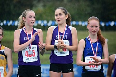 TIMES FILE PHOTO - Sunset girls cross country runners Kelly Makin (left) and Ember Stratton (right) were named first-team all-Metro League after helping the Apollos take second in Metro.