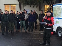 SUBMITTED PHOTO - Larry Goff delivers the Liason Officer portion of the morning briefing the to the day crews in Lake Lure, North Carolina.