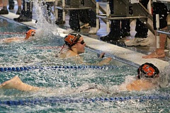 PIONEER PHOTO: CONNER WILLIAMS  - Junior Savannah Cruthers narrowly edges out two Silverton swimmers to win the 50 Freestyle race at Molalla's home swim meet on Thursday, Dec. 1 at the Molalla Aquatic Center.