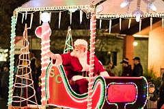 NEWS-TIMES PHOTOS: CHASE ALLGOOD - Santa Clause visits downtown on a light parade float.