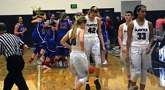 TIMES PHOTO: MATT SINGLEDECKER - The Southridge girls basketball team walks off the floor after losing to La Salle in the Nike Interstate Shootout on Thursday.