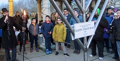 COURTESY PHOTO - Rabbi Menachem Rivkin, far left, gets ready to light a giant menorah during a Chanukah celebration held Dec. 25 at Orenco Station's Central Park.
