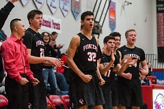OUTLOOK PHOTO: JOSH KULLA - The Oregon City bench cheers another bucket in Friday's 54-32 win over Centennial (Gresham).