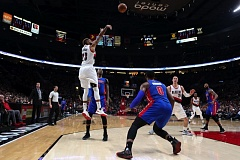 TRIBUNE PHOTO: DAVID BLAIR - Allen Crabbe of the Trail Blazers shoots on the way to 30 points Sunday night in a two-overtime loss at home to the Detriot Pistons.