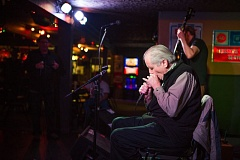 TRIBUNE PHOTO: ADAM WICKHAM - Harmonica players of all abilities have taken in the Arthur Moore Harmonica Party at Duff's Garage, 2530 N.E. 82nd Ave. Moore enjoys hearing 'week to week, the incredible growth of their harp chops.'