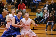 TIMES PHOTO: CONNER WILLIAMS  - Sophomore power forward Isaac Flemer gets position against Molallas Gavin Thrower.