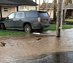 Molalla street flooded after car hits hydrant