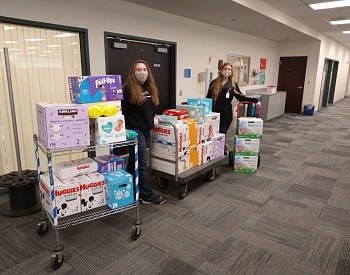 Troutdale Girl Scout donates diapers and wipes