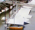 Snow and ice sink dozens of boats at Sellwood Marina