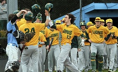 PMG PHOTO: MILES VANCE - West Linn sophomore Jonathon Kelly (No. 13) raises his helmet in celebration after he hit a first-inning grand slam in his team's 11-1 win at Lakeridge High School on Friday.