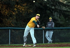 PMG PHOTO: MILES VANCE - West Linn third baseman Jake Porter turns a game-ending double play in his team's 11-1 win over Lakeridge at Lakeridge High School on Friday.