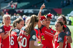 TRIBUNE PHOTO: CHRISTOPHER OERTELL - Nadia Nadim and Portland Thorns teammates celebrate after their 2-0 win Saturday against the Orlando Pride. Nadim scored the first goal on a first-half penalty kick.