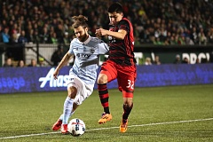 TRIBUNE PHOTO: JAIME VALDEZ - Portland Timbers defender Marco Farfan (right) defends Sporting Kansas City midfielder Graham Zusi in the second half Saturday night at Providence Park.