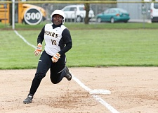 TRIBUNE PHOTO: JONATHAN HOUSE - Jenesis Spires of Roosevelt rounds third base to score as the Roughriders defeat Lincoln 7-1 in PIL softball at Delta Park.