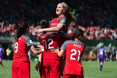 TRIBUNE PHOTO: CHRISTOPHER OERTELL - Midfielder Lindsey Horan jumps into the arms of Portland Thorns teammate Christine Sinclair in a crowd of happy homefield players Saturday.