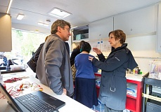 TIMES PHOTO: JONATHAN HOUSE - John Bartholomew, chairman of Tualatin's team in the nationwide America's Best Communities competition, talks with U.S. Rep. Suzanne Bonamici inside the Mobile Makerspace trailer that is his brainchild.