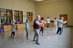 SUBMITTED PHOTO - During one of the mini tai chi classes offered last year, fair attendees were encouraged to drop-in on the class to experience the flow of the class and be inspired to sign up for the full-length, weekly version.