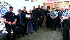 SUBMITTED PHOTO: WALUGA NEIGHBORHOOD ASSOCIATION - Lake Oswego Police Chief Don Johnson (holding plaque) and several of his officers accept a 'Random Act of Appreciation' from the Waluga Neighborhood Association. Neighborhood board member Cheryl Uchida is to Johnson's left, board member Dick Benedetti to his right.