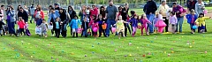 SPOKESMAN PHOTO: LESLIE PUGMIRE HOLE - Youngsters dash for candy and prizes during the annual Easter Egg Hunt in Wilsonvilles Memorial Park Saturday, April 15. Hidden in four eggs was a ticket awarded a lucky child a bicycle donated by Hope Assembly Church. See page  5 for more photos.
