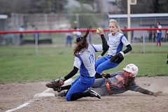WILL DENNER/MADRAS PIONEER - Gladstone junior Amanda Ward slides safely into third after Patt attempted to tag her out.
