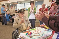 TIMES PHOTO:  JAIME VALDEZ - World War II Veteran Ubran Kluthe gives the thumbs up after blowing out the candles on his birthday cake for his 98th birthday ceremony at the Elsie Stuhr Center.