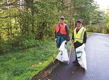 MOLALLA RIVER WATCH - Volunteers cleaning up alongside a road in the Molalla River Corridor at last year's annual cleanup event.