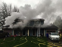 COURTESY PHOTO - A Cornelius duplex housing 12 people caught fire Thursday, April 20, but all residents got out safely.
