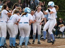 REVIEW PHOTO: MILES VANCE - Lakeridge's Kelly Ericson (right) jumps toward home plate - and her teammmates - after her two-run homer helped beat Lake Oswego 11-1 on Friday afternoon.