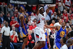 TRIBUNE PHOTO: JOSH KULLA - Noah Vonleh dunks for the Trail Blazers during Game 3 on Saturday night against Golden State.