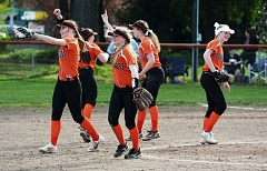 SPOTLIGHT PHOTO: JAKE MCNEAL - The Scappoose softball team celebrates during its 11-1 win over Banks at Scappoose High School on Friday.