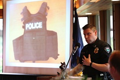 TIMES PHOTO: JAIME VALDEZ - Police Chief Bill Steele shows a photo of a tactical armor vest purchased for the Tualatin Police Department last year with the support of the Tualatin Community Police Foundation at Tuesday's fundraiser.