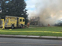 INDEPENDENT PHOTO: LINDSAY KEEFER - The fire is located at a vacant barn on Hardcastle Avenue east of Highway 99E.