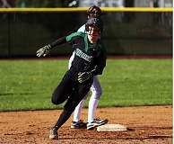 DAN BROOD - Tigard High School freshman Lexi Klum rounds second base and heads to third for a triple in the second inning of the Tigers' 10-1 win over Lakeridge.