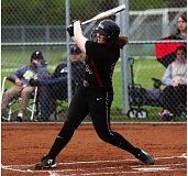 DAN BROOD - Tualatin High  School sophomore Emily Johansen smacks a first-inning double during the Timberwolves' game at Tigard. Tualatin was holding a 5-0 lead when the contest was rained out.