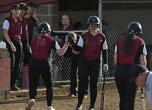 TIMES PHOTO: MATT SINGLEDECKER - Southridge senior catcher Brooke Johnson congratulates Madison Goodale after her inside-the-park homer.