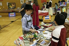 SPOKESMAN PHOTOS: ANDREW KILSTROM - Boeckman Creek Primary's Sage Farrell shares his German culture with classmates at International Night Friday, April 28.