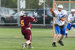 NEWS-TIMES PHOTO: CHRISTOPHER OERTELL - Forest Grove freshman Ladd McLaughlin (5) shoots towards the goal during a lacrosse game against Hillsboro at South Meadows Middle School in Hillsboro.