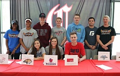 REVIEW/NEWS PHOTO: JIM BESEDA - Clackamas High School student-athletes (standing, left to right) Monnie Spears-Rogers, Tyler Thomas, Tayton LaPointe, Grant Brobeck, Patrick Gregg, Jake McGreevy, Carlos Nelson, (seated, left to right) Amanda Grimshaw, Maddie Cole, and Matt O'Brien confirmed their college commitments during a Thursday ceremony in the school's media center. (Not pictured: Quincy Baker, Denise Dao, Maddy Oakden, and Taylor Morris.)