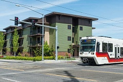 HILLSBORO TRIBUNE PHOTO: CHRIS OERTELL - A light rail train passes in front of the Orchards at Orenco affordable housing development. Washington County generally looks to place affordable developments near public transit, but the apartments fill up quickly.