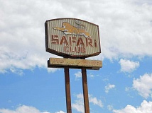 ESTACADA NEWS PHOTO: EMILY LINDSTRAND - The iconic Safari Club sign is located at the corner of Fourth Avenue and Broadway Street. City leaders hope to safe the sign after the building is demolished to make way for a Dollar General store in several weeks.