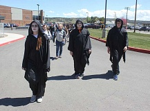 SUSAN MATHENY/MADRAS PIONEER - Students dressed as the walkin dead escort juniors and seniors to the mock crash scene.